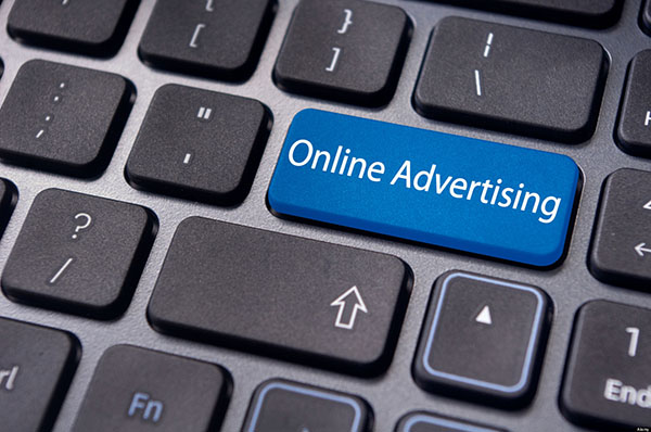 concepts of online advertising, with message on keyboard.